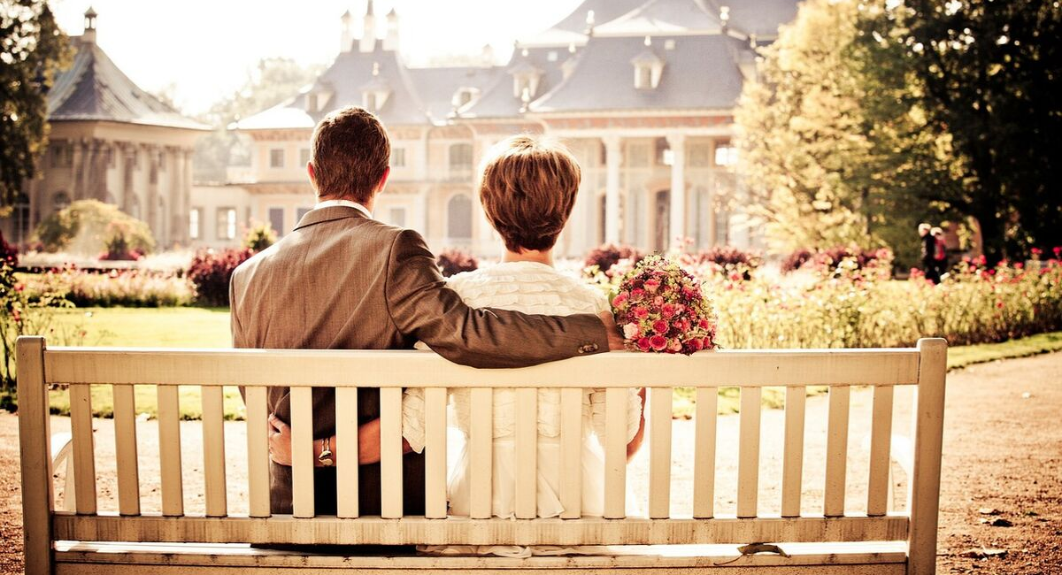 Wedding Loans | married couple sitting on a bench reflecting