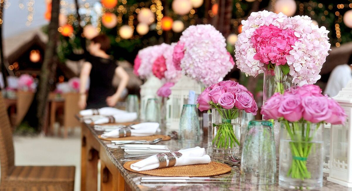 Wedding Loans | pink flowers at a wedding reception