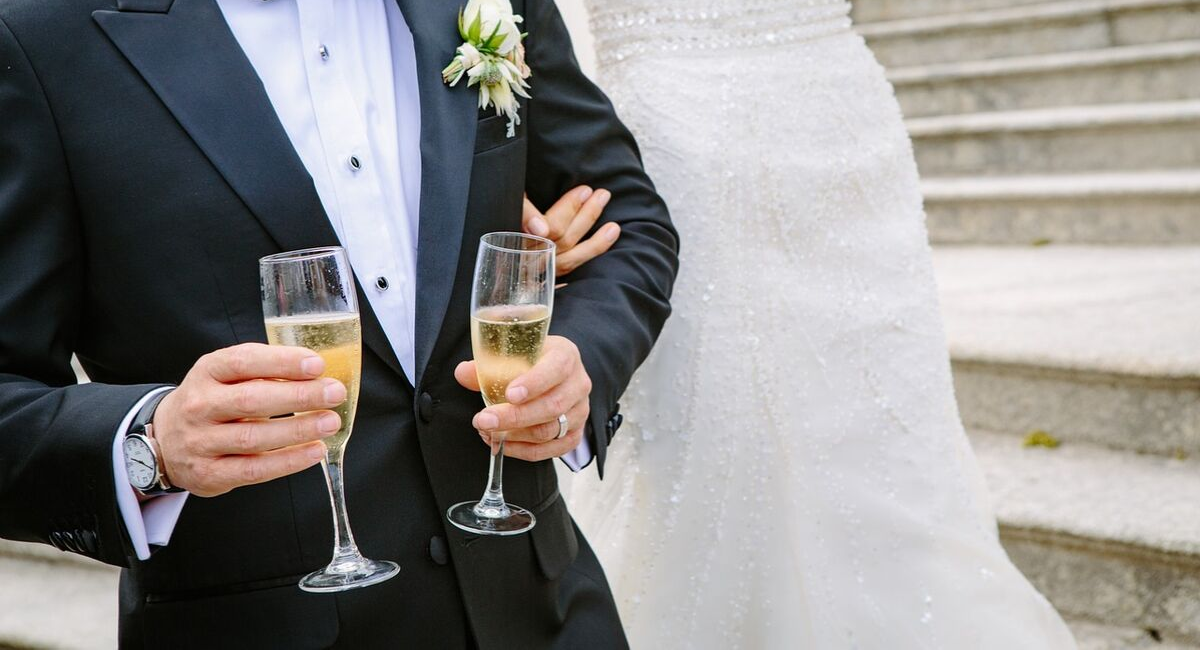 Wedding Loans | bride and groom sharing their first drink together