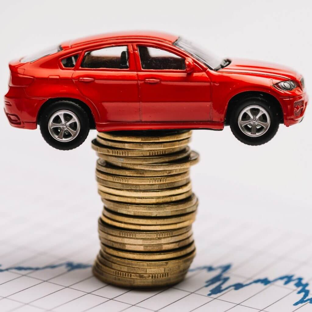 buying a car - car on stack of coins